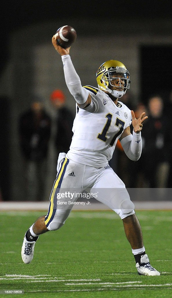 Quarterback <a gi-track='captionPersonalityLinkClicked' href=/galleries/search?phrase=Brett+Hundley&family=editorial&specificpeople=8674236 ng-click='$event.stopPropagation()'>Brett Hundley</a> #17 of UCLA passes downfield in the first quarter again Utah at Rice- Eccles Stadium October 3, 2013 in Salt Lake City, Utah.