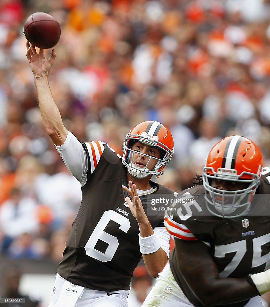 Quarterback <a gi-track='captionPersonalityLinkClicked' href=/galleries/search?phrase=Brian+Hoyer&family=editorial&specificpeople=4018159 ng-click='$event.stopPropagation()'>Brian Hoyer</a> #6 of the Cleveland Browns gets a block from offensive lineman Oniel Cousins #75 as he throws to a receiver against the Cincinnati Bengals at FirstEnergy Stadium on September 29, 2013 in Cleveland, Ohio.