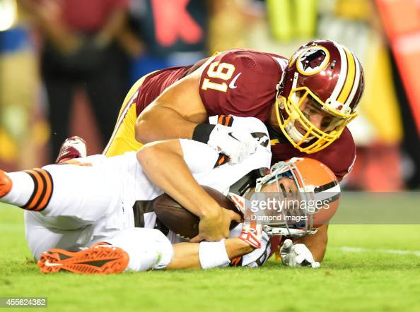 Quarterback Brian Hoyer of the Cleveland Browns is sacked by linebacker Ryan Kerrigan of the Washington Redskins during a game against the Washington...