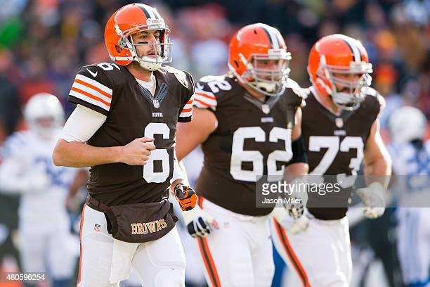 Quarterback Brian Hoyer tackle Michael Bowie and tackle Joe Thomas of the Cleveland Browns run on the field during the first half against the...