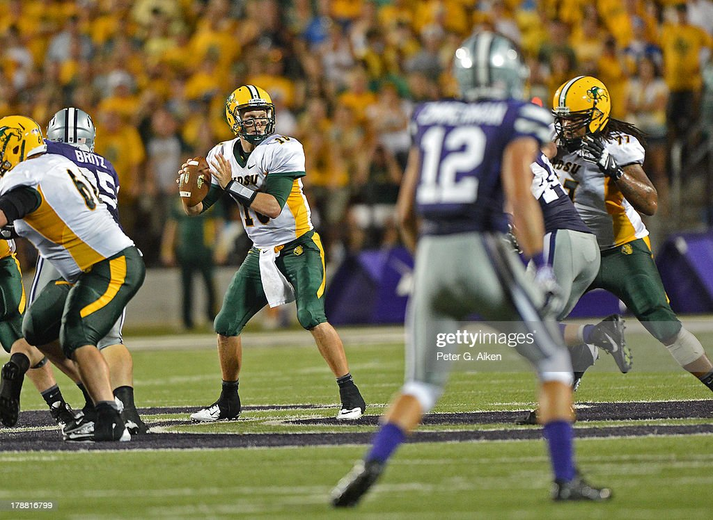 Quarterback Brock Jensen of the North Dakota State Bison drops back to pass against the Kansas State Wildcats during the second half on August 30...