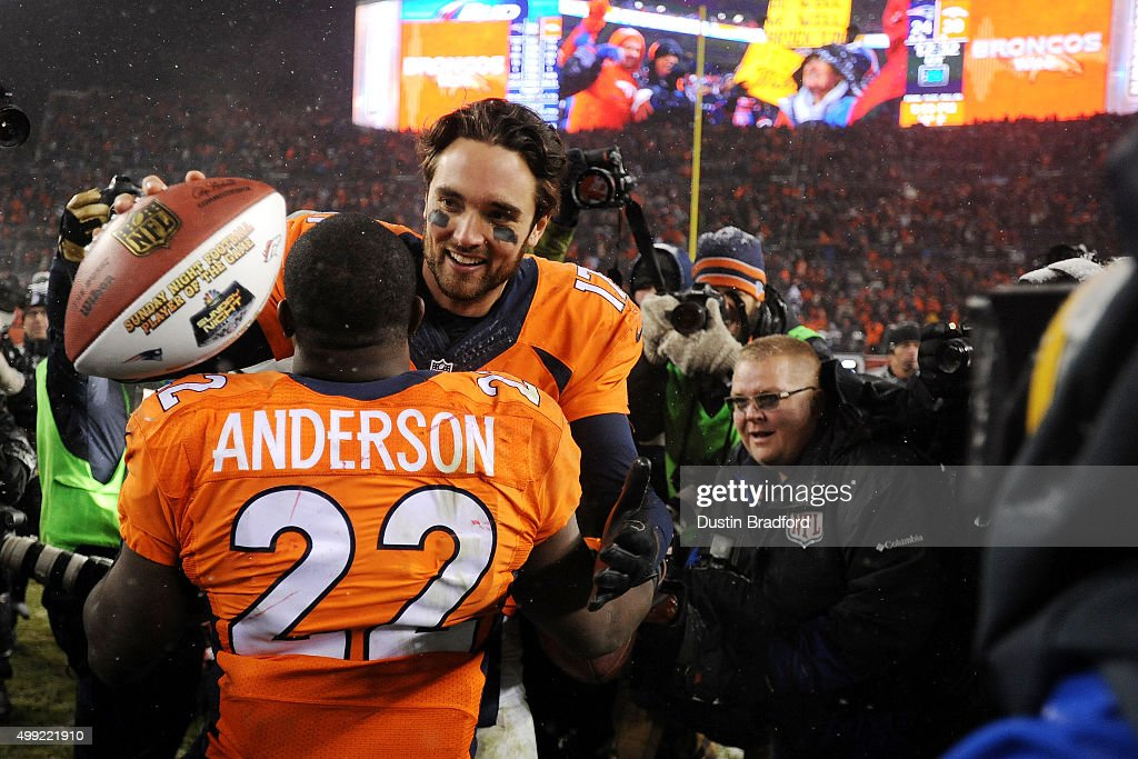 Quarterback <a gi-track='captionPersonalityLinkClicked' href=/galleries/search?phrase=Brock+Osweiler&family=editorial&specificpeople=6501030 ng-click='$event.stopPropagation()'>Brock Osweiler</a> #17 of the Denver Broncos celebrates with running back <a gi-track='captionPersonalityLinkClicked' href=/galleries/search?phrase=C.J.+Anderson+-+American+Football+Player&family=editorial&specificpeople=11333631 ng-click='$event.stopPropagation()'>C.J. Anderson</a> #22 of the Denver Broncos after defeating the New England Patriots 30-24 in overtime at Sports Authority Field at Mile High on November 29, 2015 in Denver, Colorado.