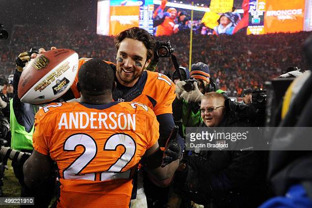 Quarterback Brock Osweiler of the Denver Broncos celebrates with running back CJ Anderson of the Denver Broncos after defeating the New England...