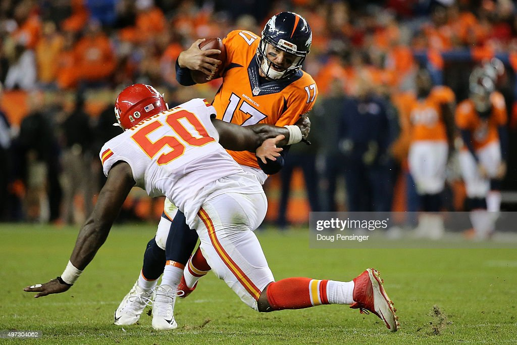 Quarterback <a gi-track='captionPersonalityLinkClicked' href=/galleries/search?phrase=Brock+Osweiler&family=editorial&specificpeople=6501030 ng-click='$event.stopPropagation()'>Brock Osweiler</a> #17 of the Denver Broncos is sacked by linebacker <a gi-track='captionPersonalityLinkClicked' href=/galleries/search?phrase=Justin+Houston&family=editorial&specificpeople=5541929 ng-click='$event.stopPropagation()'>Justin Houston</a> #50 of the Kansas City Chiefs in the fourth quater at Sports Authority Field at Mile High on November 15, 2015 in Denver, Colorado.