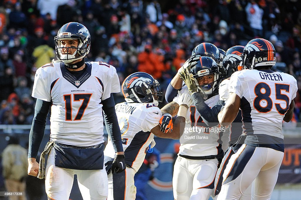 Quarterback <a gi-track='captionPersonalityLinkClicked' href=/galleries/search?phrase=Brock+Osweiler&family=editorial&specificpeople=6501030 ng-click='$event.stopPropagation()'>Brock Osweiler</a> #17 of the Denver Broncos reacts as <a gi-track='captionPersonalityLinkClicked' href=/galleries/search?phrase=Cody+Latimer&family=editorial&specificpeople=8534820 ng-click='$event.stopPropagation()'>Cody Latimer</a> #14 celebrates with teammates after scoring against the Chicago Bears in the fourth quarter at Soldier Field on November 22, 2015 in Chicago, Illinois.