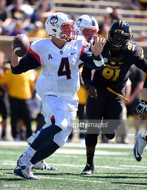 Quarterback Bryant Shirreffs of the Connecticut Huskies looks to pass against Charles Harris of the Missouri Tigers in the fourth quarter at Memorial...