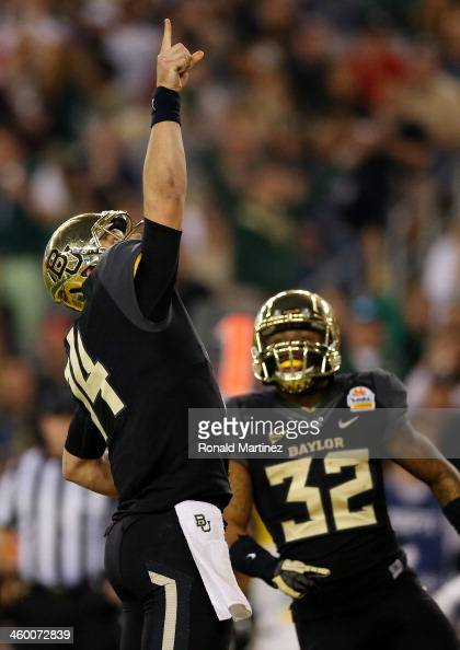 Quarterback Bryce Petty of the Baylor Bears celebrates a touchdown in the third quarter against the UCF Knights during the Tostitos Fiesta Bowl at...