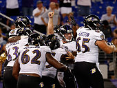 Quarterback Bryn Renner of the Baltimore Ravens celebrates after scoring the go ahead touchdown late in the fourth quarter to give the Ravens a 3027...