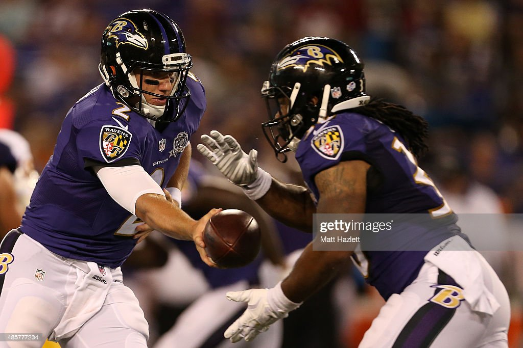 Quarterback <a gi-track='captionPersonalityLinkClicked' href=/galleries/search?phrase=Bryn+Renner&family=editorial&specificpeople=6786211 ng-click='$event.stopPropagation()'>Bryn Renner</a> #2 of the Baltimore Ravens hands the ball off to running back Terrence Magee #30 of the Baltimore Ravens in the fourth quarter of a preseason game against the Washington Redskins at M&T Bank Stadium on August 29, 2015 in Baltimore, Maryland.