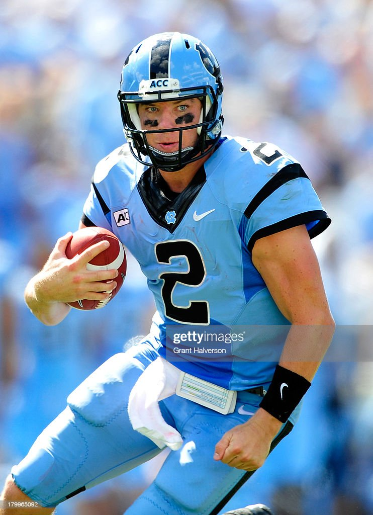Quarterback <a gi-track='captionPersonalityLinkClicked' href=/galleries/search?phrase=Bryn+Renner&family=editorial&specificpeople=6786211 ng-click='$event.stopPropagation()'>Bryn Renner</a> #2 of the North Carolina Tar Heels looks to run against the Middle Tennessee State Blue Raiders during play at Kenan Stadium on September 7, 2013 in Chapel Hill, North Carolina. North Carolina won 40-20.