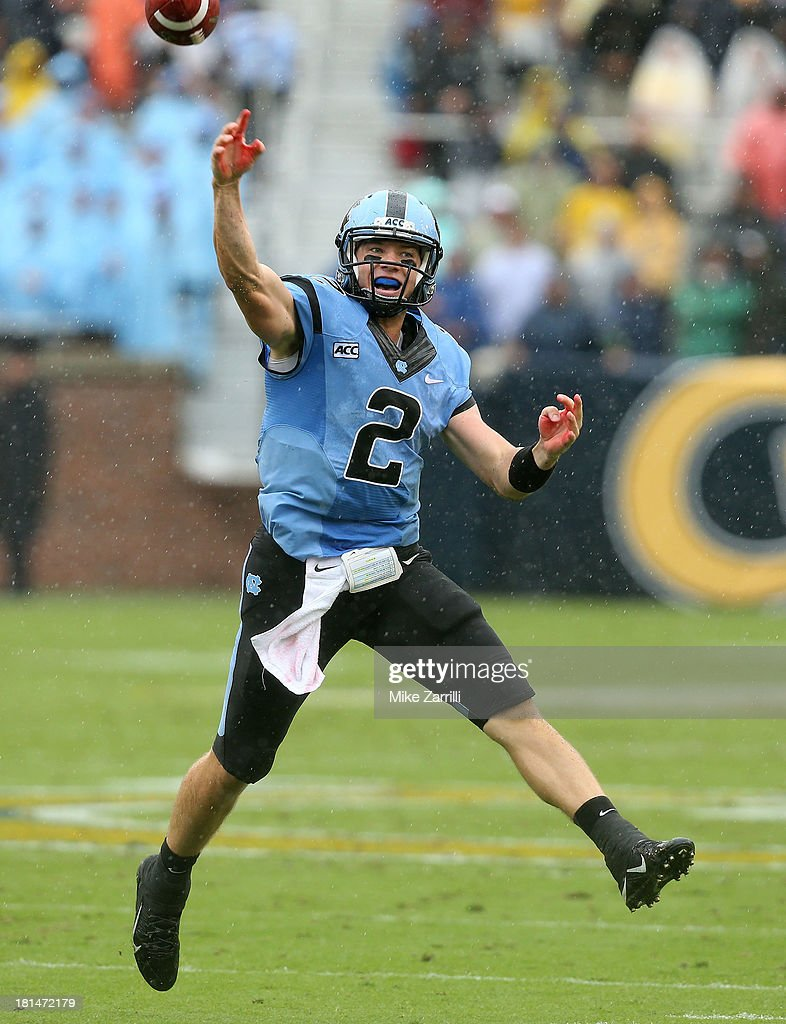 Quarterback <a gi-track='captionPersonalityLinkClicked' href=/galleries/search?phrase=Bryn+Renner&family=editorial&specificpeople=6786211 ng-click='$event.stopPropagation()'>Bryn Renner</a> #2 of the North Carolina Tar Heels scrambles and throws a pass during the game against the Georgia Tech Yellow Jackets at Bobby Dodd Stadium at Historic Grant Field on September 21, 2013 in Atlanta, Georgia.