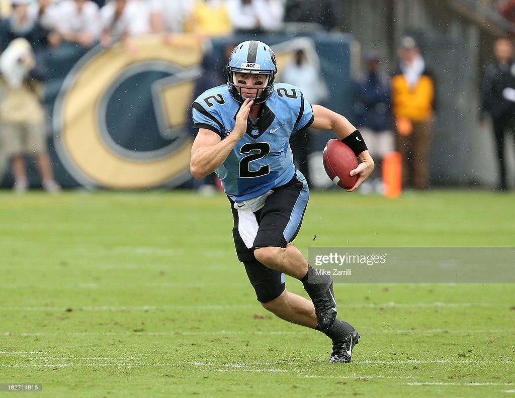 Quarterback <a gi-track='captionPersonalityLinkClicked' href=/galleries/search?phrase=Bryn+Renner&family=editorial&specificpeople=6786211 ng-click='$event.stopPropagation()'>Bryn Renner</a> #2 of the North Carolina Tar Heels scrambles during the game against the Georgia Tech Yellow Jackets at Bobby Dodd Stadium at Historic Grant Field on September 21, 2013 in Atlanta, Georgia.