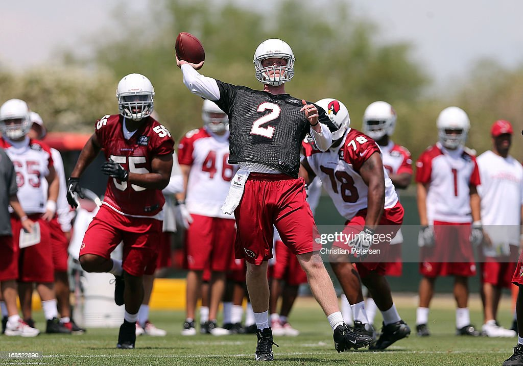 Quarterback Caleb TerBush #2 of the Arizona Cardinals throws a pass as he practices at the team's training center facility on May 10, 2013 in Tempe, Arizona.