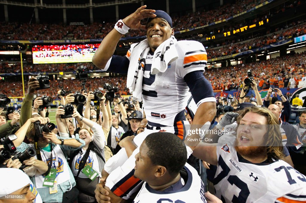 Quarterback <a gi-track='captionPersonalityLinkClicked' href=/galleries/search?phrase=Cam+Newton+-+American+Football+Quarterback&family=editorial&specificpeople=4516761 ng-click='$event.stopPropagation()'>Cam Newton</a> #2 of the Auburn Tigers celebrates after their 56-17 win over the South Carolina Gamecocks during the 2010 SEC Championship at Georgia Dome on December 4, 2010 in Atlanta, Georgia.