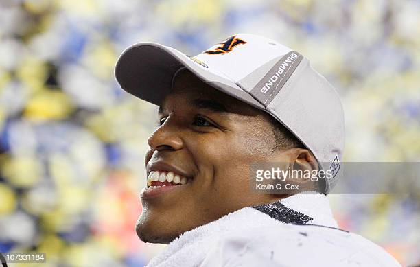 Quarterback Cam Newton of the Auburn Tigers celebrates after their 5617 win over the South Carolina Gamecocks during the 2010 SEC Championship at...