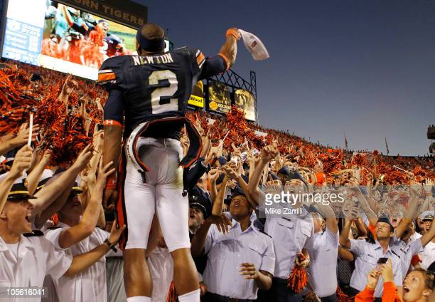 Quarterback Cam Newton of the Auburn Tigers celebrates with the crowd after the game against the Arkansas Razorbacks at JordanHare Stadium on October...