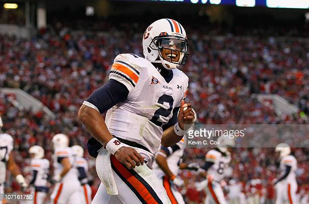 Quarterback Cam Newton of the Auburn Tigers reacts after a touchdown against the Alabama Crimson Tide at BryantDenny Stadium on November 26 2010 in...