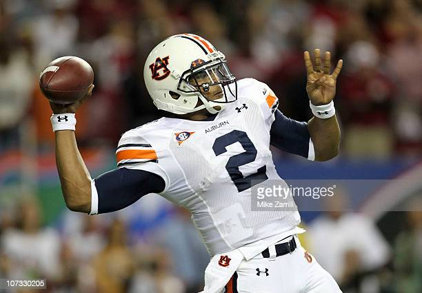 Quarterback Cam Newton of the Auburn Tigers throws a pass during the 2010 SEC Championship against the South Carolina Gamecocks at Georgia Dome on...