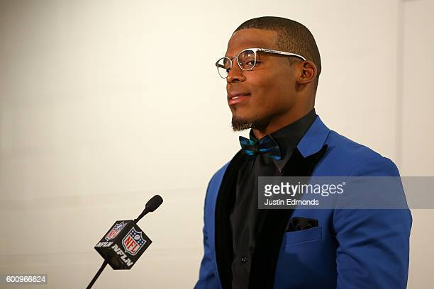 Quarterback Cam Newton of the Carolina Panthers addresses the media following their 2120 loss to the Denver Broncos at Sports Authority Field Field...