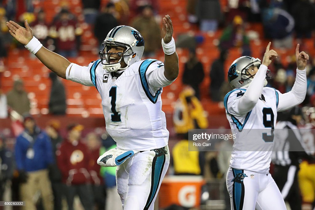 Quarterback Cam Newton #1 of the Carolina Panthers and teammate kicker Graham Gano #9 react after a fourth quarter field goal against the Washington Redskins at FedExField on December 19, 2016 in Landover, Maryland.