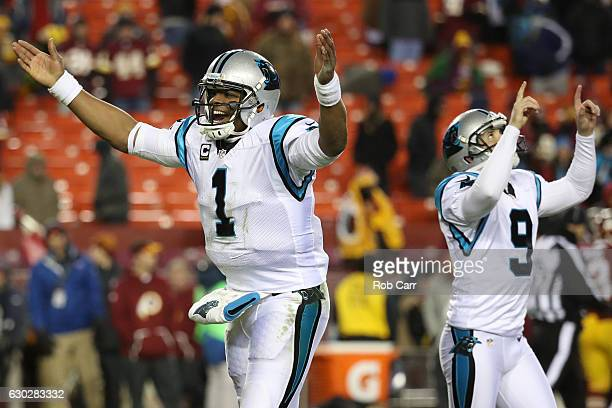 Quarterback Cam Newton of the Carolina Panthers and teammate kicker Graham Gano react after a fourth quarter field goal against the Washington...