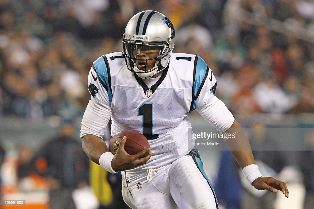 Quarterback <a gi-track='captionPersonalityLinkClicked' href=/galleries/search?phrase=Cam+Newton+-+American+Football+Quarterback&family=editorial&specificpeople=4516761 ng-click='$event.stopPropagation()'>Cam Newton</a> #1 of the Carolina Panthers carries the ball during a game against the Philadelphia Eagles on November 26, 2012 at Lincoln Financial Field in Philadelphia, Pennsylvania. The Panthers won 30-22.
