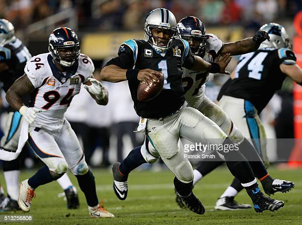 Quarterback Cam Newton of the Carolina Panthers carries the ball against the Denver Broncos during Super Bowl 50 at Levi's Stadium on February 7 2016...