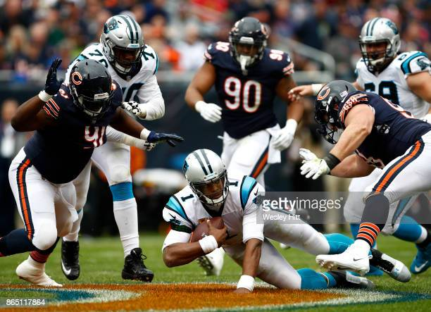 Quarterback Cam Newton of the Carolina Panthers carries the football against the Chicago Bears in the second quarter at Soldier Field on October 22...