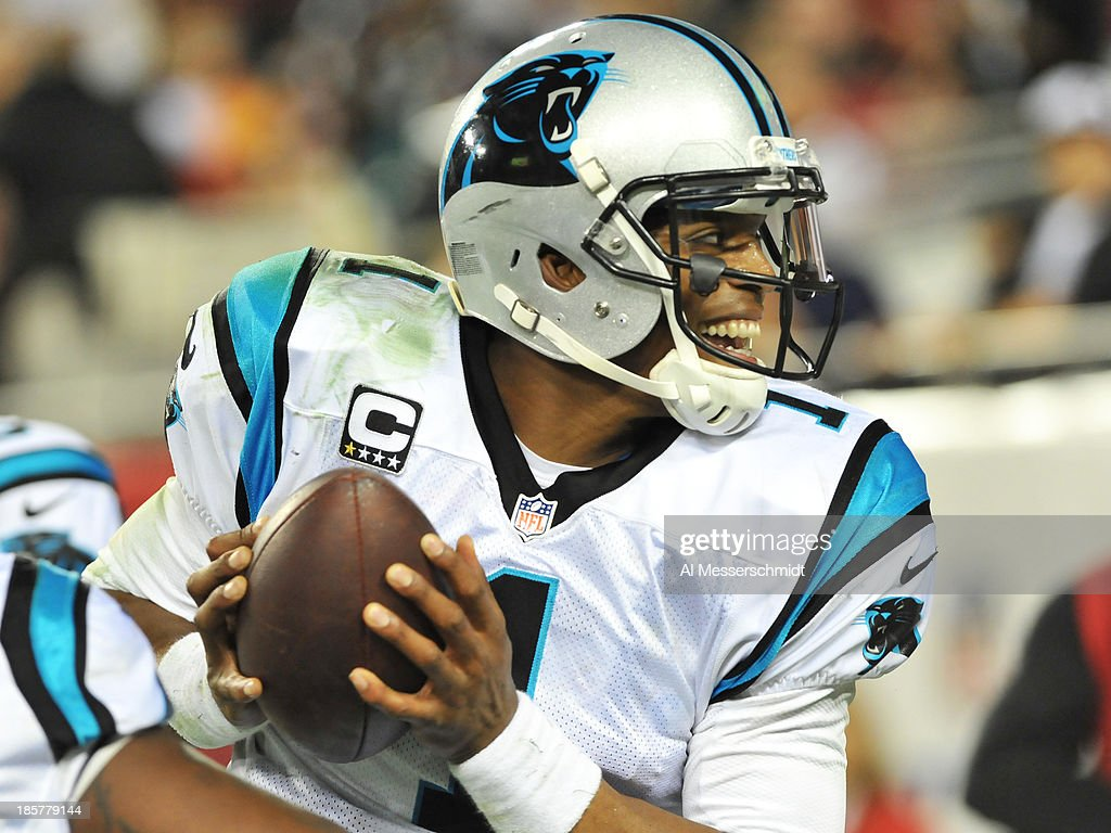 Quarterback <a gi-track='captionPersonalityLinkClicked' href=/galleries/search?phrase=Cam+Newton+-+American+Football+Quarterback&family=editorial&specificpeople=4516761 ng-click='$event.stopPropagation()'>Cam Newton</a> #1 of the Carolina Panthers celebrates after a touchdown run against the Tampa Bay Buccaneers October 24, 2013 at Raymond James Stadium in Tampa, Florida. Carolina won 31 - 13.