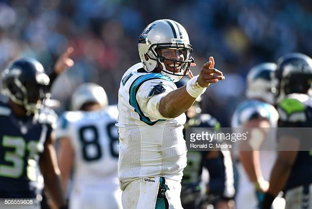 Quarterback Cam Newton of the Carolina Panthers celebrates during the NBC Divisional Playoff Game against the Seattle Seahawks at Bank of America...
