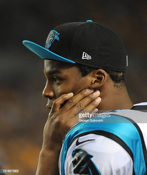 Quarterback Cam Newton of the Carolina Panthers looks on from the sideline during a preseason game against the Pittsburgh Steelers at Heinz Field on...