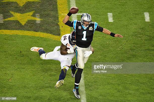 Quarterback Cam Newton of the Carolina Panthers looks to pass and escape tackle from DeMarcus Ware of the Denver Broncos during Super Bowl 50 at...
