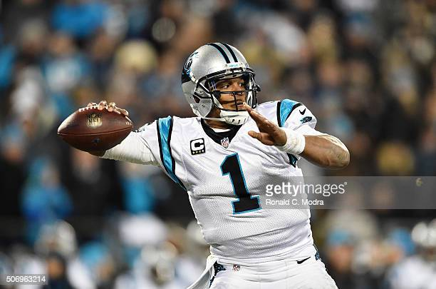 Quarterback Cam Newton of the Carolina Panthers passes during the NFC Championship Game against the Arizona Cardinals at Bank of America Stadium on...