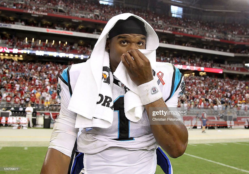Quarterback <a gi-track='captionPersonalityLinkClicked' href=/galleries/search?phrase=Cam+Newton+-+American+Football+Quarterback&family=editorial&specificpeople=4516761 ng-click='$event.stopPropagation()'>Cam Newton</a> #1 of the Carolina Panthers reacts as he walks off the field following the NFL season opening game against the Arizona Cardinals at the University of Phoenix Stadium on September 11, 2011 in Glendale, Arizona. The Cardinals defeated the Panthers 28-21.