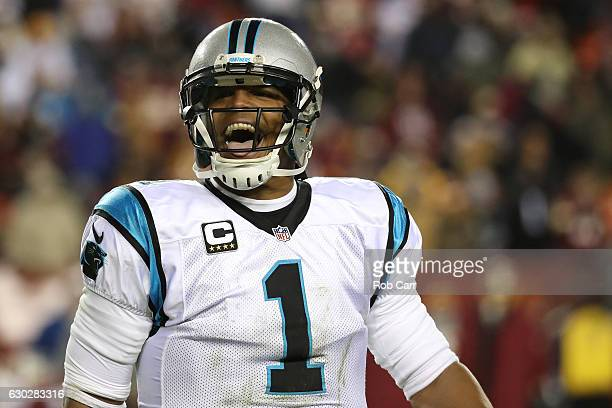 Quarterback Cam Newton of the Carolina Panthers reacts during the closing minutes of the fourth quarter against the Washington Redskins at FedExField...