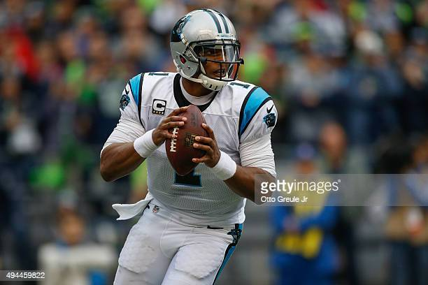 Quarterback Cam Newton of the Carolina Panthers rolls out to pass against the Seattle Seahawks at CenturyLink Field on October 18 2015 in Seattle...