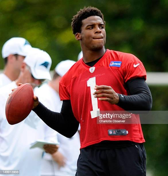 Quarterback Cam Newton of the Carolina Panthers runs through drills during training camp in Spartanburg South Carolina on Monday August 6 2012