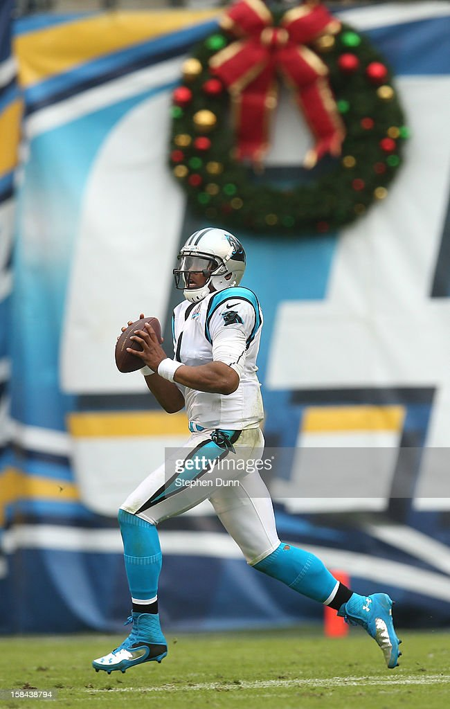 Quarterback <a gi-track='captionPersonalityLinkClicked' href=/galleries/search?phrase=Cam+Newton+-+American+Football+Quarterback&family=editorial&specificpeople=4516761 ng-click='$event.stopPropagation()'>Cam Newton</a> #1 of the Carolina Panthers scrambles against the San Diego Chargers at Qualcomm Stadium on December 16, 2012 in San Diego, California. The Panthers won 31-7.