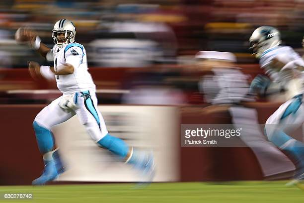 Quarterback Cam Newton of the Carolina Panthers scrambles with the ball against the Washington Redskins in the first quarter at FedExField on...