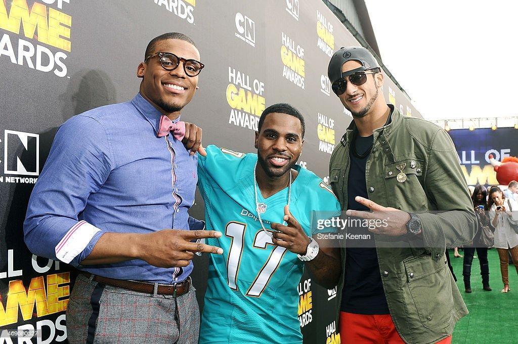 Quarterback Cam Newton of the Carolina Panthers singer Jason Derulo and quarterback Colin Kaepernick of the San Francisco 49ers attend Cartoon...