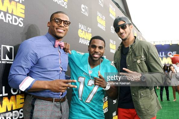 Quarterback Cam Newton of the Carolina Panthers singer Jason Derulo and quarterback Colin Kaepernick of the San Francisco 49ers attend Cartoon...