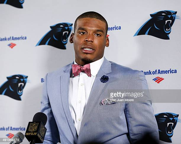 Quarterback Cam Newton of the Carolina Panthers talks with the media after the game against the Tampa Bay Buccaneers at Raymond James Stadium on...