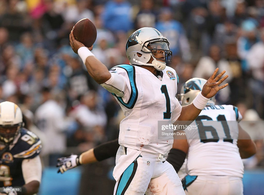 Quarterback <a gi-track='captionPersonalityLinkClicked' href=/galleries/search?phrase=Cam+Newton+-+American+Football+Quarterback&family=editorial&specificpeople=4516761 ng-click='$event.stopPropagation()'>Cam Newton</a> #1 of the Carolina Panthers throws a pass against the San Diego Chargers at Qualcomm Stadium on December 16, 2012 in San Diego, California. The Panthers won 31-7.
