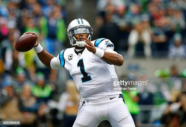 Quarterback Cam Newton of the Carolina Panthers throws a pass against the Seattle Seahawks at CenturyLink Field on October 18 2015 in Seattle...