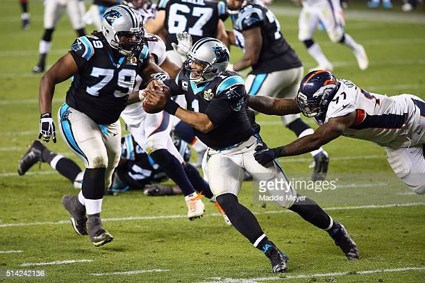 Quarterback Cam Newton of the Carolina Panthers tries to escape a tackle from Malik Jackson of the Denver Broncos during Super Bowl 50 at Levi's...