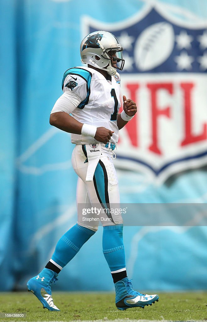 Quarterback <a gi-track='captionPersonalityLinkClicked' href=/galleries/search?phrase=Cam+Newton+-+American+Football+Quarterback&family=editorial&specificpeople=4516761 ng-click='$event.stopPropagation()'>Cam Newton</a> #1 of the Carolina Panthers trots to his huddle in the game against the San Diego Chargers at Qualcomm Stadium on December 16, 2012 in San Diego, California. The Panthers won 31-7.