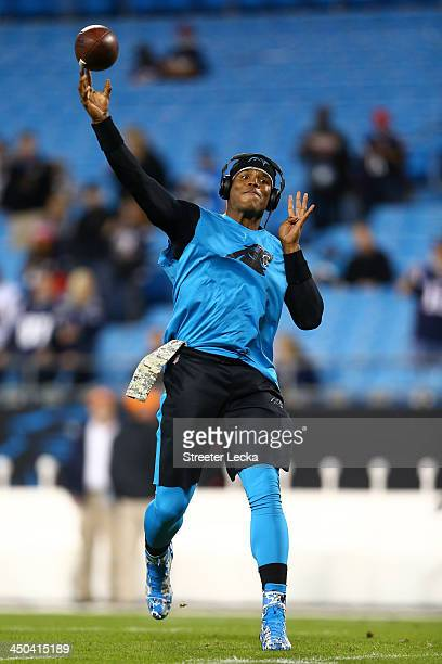 Quarterback Cam Newton of the Carolina Panthers warmsup before taking on the New England Patriots at Bank of America Stadium on November 18 2013 in...