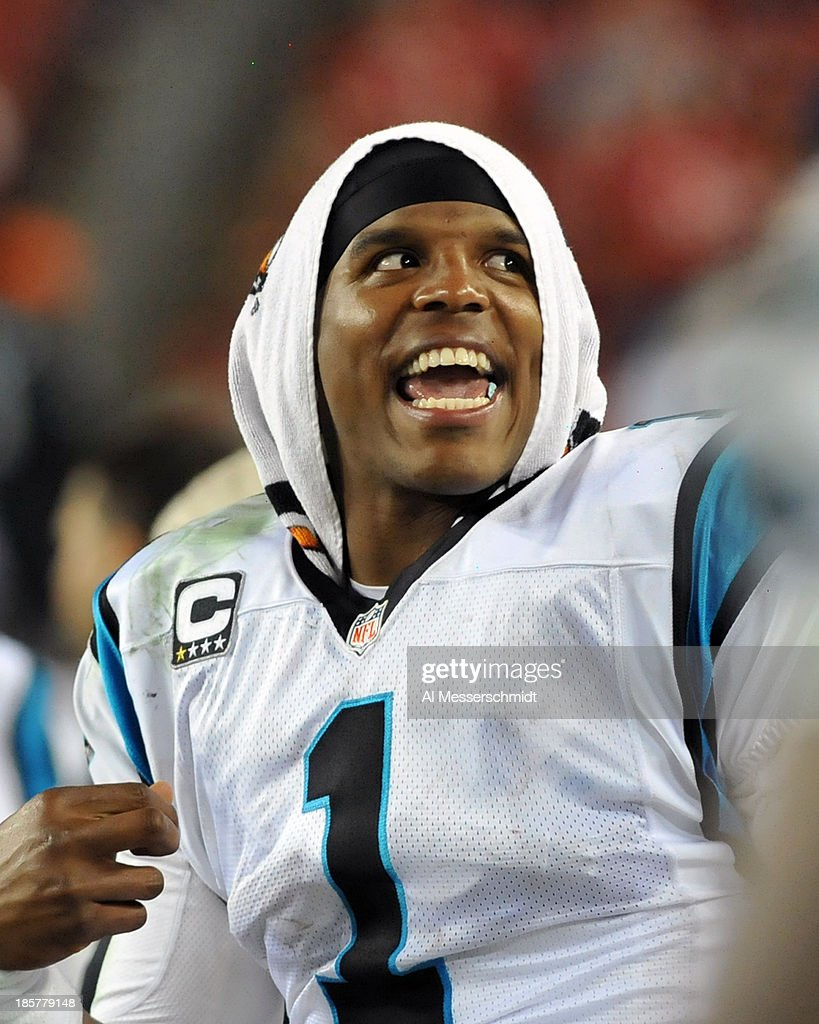 Quarterback <a gi-track='captionPersonalityLinkClicked' href=/galleries/search?phrase=Cam+Newton+-+American+Football+Quarterback&family=editorial&specificpeople=4516761 ng-click='$event.stopPropagation()'>Cam Newton</a> #1 of the Carolina Panthers watches play in the 4th quarter against the Tampa Bay Buccaneers October 24, 2013 at Raymond James Stadium in Tampa, Florida. Carolina won 31 - 13.