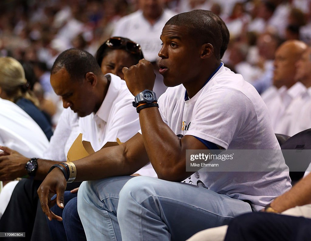 NFL quarterback Cam Newton sits courtside during Game Seven of the 2013 NBA Finals at AmericanAirlines Arena on June 20, 2013 in Miami, Florida.
