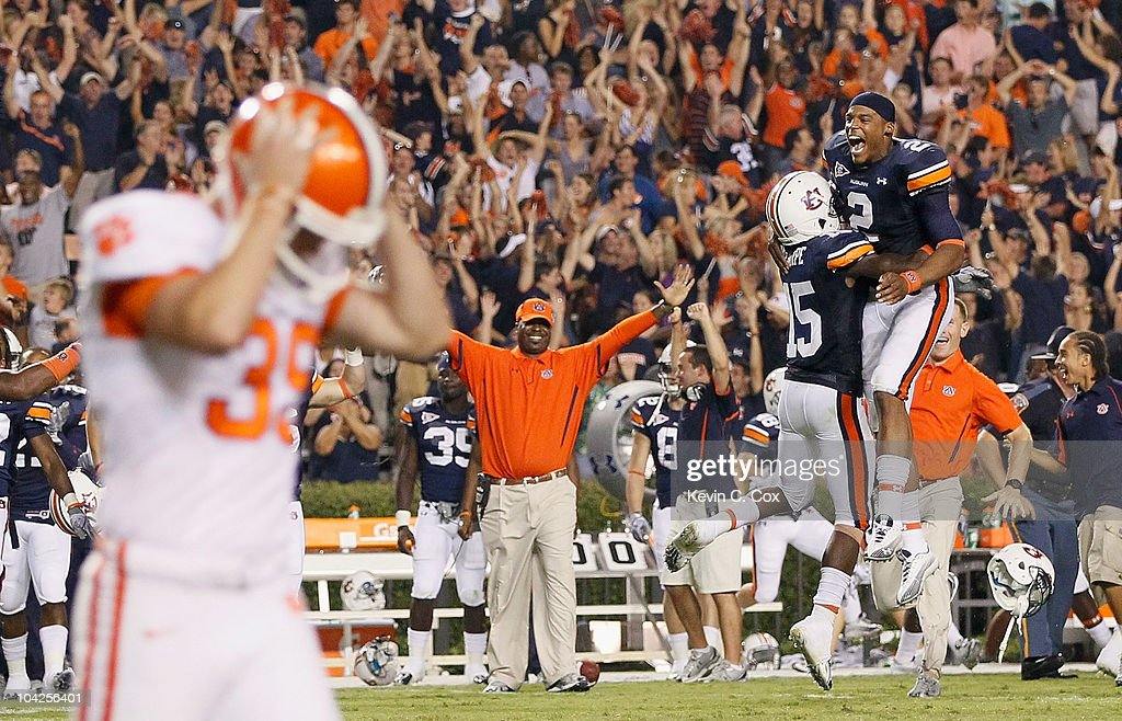 Quarterback Cameron Newton #2 and Neiko Thorpe #15 of the Auburn Tigers celebrate after Chandler Catanzaro #39 of the Clemson Tigers missed a field goal in overtime to give the Auburn Tigers a 27-24 win at Jordan-Hare Stadium on September 18, 2010 in Auburn, Alabama.